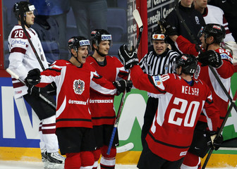 Austria's players celebrate their goal against Latvia during their 2013 IIHF Ice Hockey World Championship preliminary round match at the Hartwall Arena in Helsinki