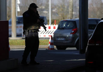 Heavily armed Swiss customs officer stands guard at the Swiss-French customs post of Bardonnex near Geneva