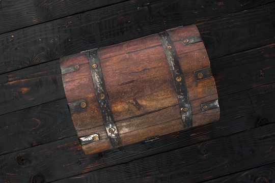 Old closed chest close up on dark wooden table