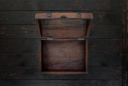 Vintage open chest close up on dark wooden table