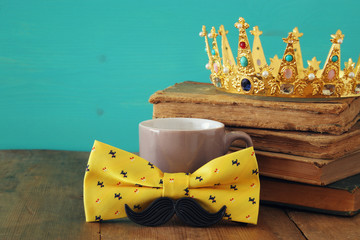 funny mustache, cup of coffee, bow and king crown. Father's day concept