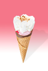 Strawberry ice cream cone with cream and almond stuffed with strawberry jam isolated on pink and white background (clipping path included)