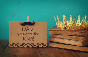 funny mustache, greeting card and king crown. Father's day concept