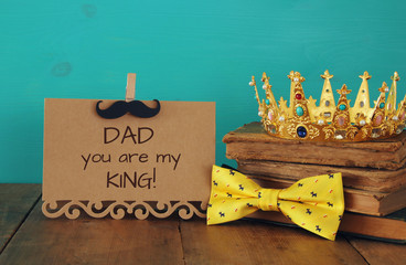 funny mustache, greeting card, bow and king crown. Father's day concept
