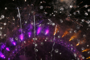 Fireworks explode around the London Eye during New Year celebrations in central London