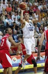 Argentina's Prigioni goes high to shoot as Jordan's Alawadi trails during their FIBA Basketball World Championship game in Kayseri