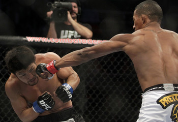 Alcantara of Brazil fights with Omigawa of Japan during the Ultimate Fighting Championship (UFC) Rio in Rio de Janeiro