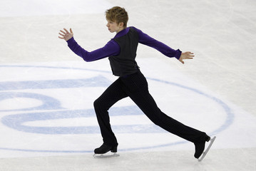 Reynolds of Canada performs during the men's short program at the ISU World Figure Skating Championships in Nice