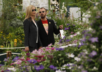 British musician Ringo Starr and his wife Barbara Bach look at displays at the Chelsea Flower Show in London