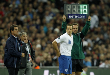 England's Kevin Davies comes on for England during their Euro 2012 qualifying soccer match against Montenegro at Wembley Stadium in London