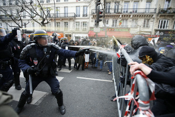 Demonstrators clash with CRS riot policemen near the Place de la Republique after the cancellation of a planned climate march  ahead of the World Climate Change Conference 2015 in Paris