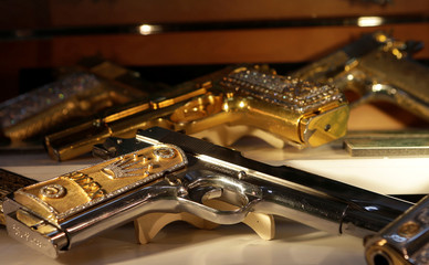 Guns decorated with gold and jewellery are displayed in the Drugs Museum, used by the military to showcase to soldiers the lifestyles of Mexican drug lords, at the headquarters of the Ministry of Defense in Mexico City