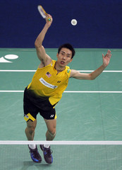 Malaysia's Lee Chong Wei hits a return to Indonesia's Taufik Hidayat in the men's singles finals of Malaysian Open Super Series 2011 badminton tournament in Kuala Lumpur