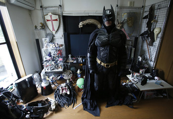 "A 41-year-old man going by the name of Chibatman poses in his room before going on the road on his ""Chibatpod"" in Chiba, east of Tokyo"