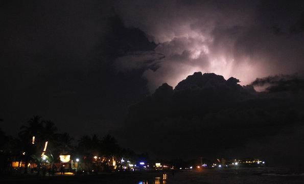 Lightning illuminates the sky before heavy rains, in Colombo