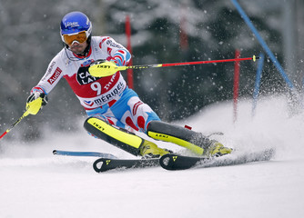 Grange of France clears a gate during the second run of the men's slalom race at the Alpine Skiing World Cup Finals in Meribel