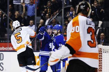 Maple Leafs' Frattin celebrates his goal with teammate MacArthur against Flyers' Coburn and goalie Bryzgalov during their NHL hockey game in Toronto