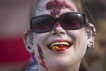 """Molly Schuyler, dressed as a zombie, smiles after winning the brain eating contest during the """"Zombie Takeover of Coney Island"""" in Coney Island in the Brooklyn borough of New York"""