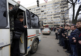 People cheer as members of Berkut anti-riot unit leave their barracks in Kiev