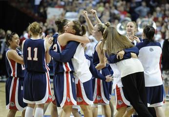 Gonzaga Bulldogs celebrate their win over the Louisville Cardinals in their NCAA Women's Spokane Regional college basketball game in Spokane