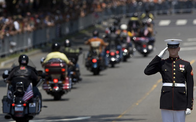 A U.S. Marine salutes motorcycle riders in the annual Rolling Thunder First Amendment Demonstration Run in Washington