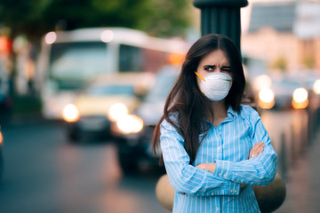 Woman With Respiratory Mask Out in Polluted City