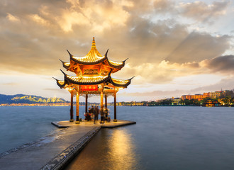 ancient pavilion of Hangzhou west lake at dusk, in China Wall mural