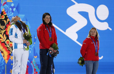 Medalists stand on the podium during the medal ceremony for the women's alpine skiing downhill race at the Sochi 2014 Winter Olympic Games in Sochi