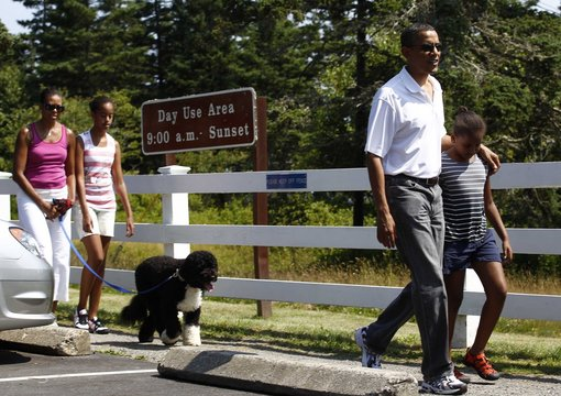 U.S. President Barack Obama walks with his daughter Sasha at the Bass Harbour Head Lighthouse  in Bass Harbor, Maine