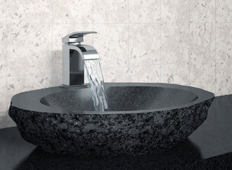 Bathroom faucet and black stone sink