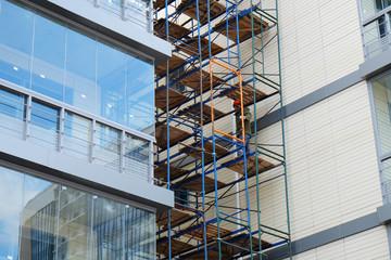 scaffolding on the facade of a modern building