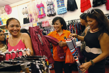Domestic helper Lisa Padua jokes as she shops for clothes with her friends on a day off, at Lucky Plaza in Singapore