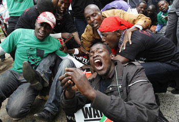 Activists shout slogans during a protest in Nairobi