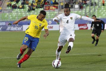 Ecuador's Quinonez challenges Bolivia's Morales during their first round Copa America 2015 soccer match at Estadio Elias Figueroa Brander in Valparaiso