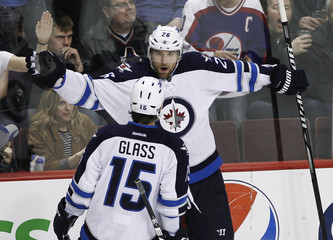 Winnipeg Jets' Wheeler celebrates his goal against the Vancouver Canucks with teammate Glass during their NHL hockey game in Vancouver