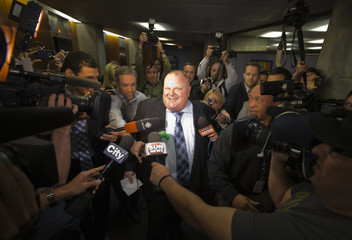 Toronto Mayor Ford walks on his way to city council executive committee meeting at City Hall in Toronto