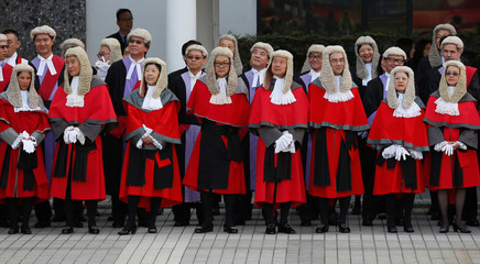 Judges wearing wigs attend a ceremony to mark the beginning of the new legal year in Hong Kong