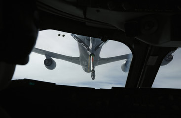 KC-135 tanker aircraft is pictured during mid-air refueling of U.S. Secretary of Defense Hagel's E-4B plane, over Newfoundland