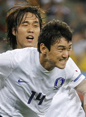 South Korea's Lee celebrates his goal next to team mate Park during the 2010 World Cup Group B soccer match against Nigeria in Durban
