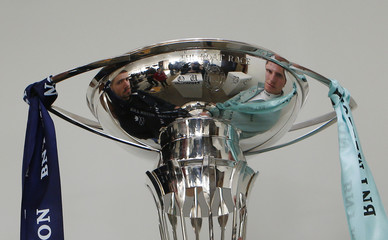 The Oxford and Cambridge crew presidents Alexander Davidson and George Nash are reflected in The Boat Race Trophy following a news conference in London