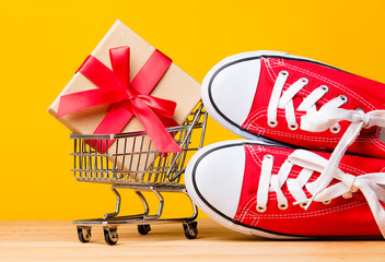 gift in shopping cart and gumshoes