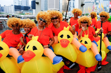 Competitors from the fancy dress competition pose for a picture. Hong Kong celebrates the Dragon Boat Festival with three days of races and parties as part of the 40th anniversary of international dragon boat racing.