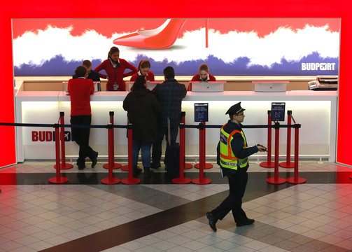 Policeman walks in front of the information desk in the departure hall of the Ferenc Liszt airport's terminal 2B in Budapes