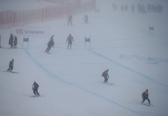 People ski down the slope after the women's Super G event of the Alpine Skiing World Cup was cancelled due to fog in Bansko