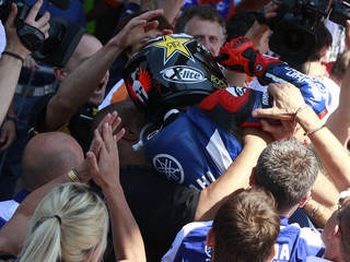 Yamaha's Lorenzo of Spain celebrates with mechanics after his victory at the Italian motorcycling Grand Prix at Mugello circuit