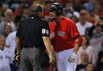 Red Sox' Youkilis argues with home plate umpire Eddings after Youkilis struck out with the bases loaded to end the sixth inning of their MLB Interleague baseball game against the Nationals at Fenway Park