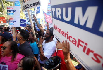 Opposing groups of protesters gather during demonstrations before the last 2016 U.S. presidential debate in Las Vegas
