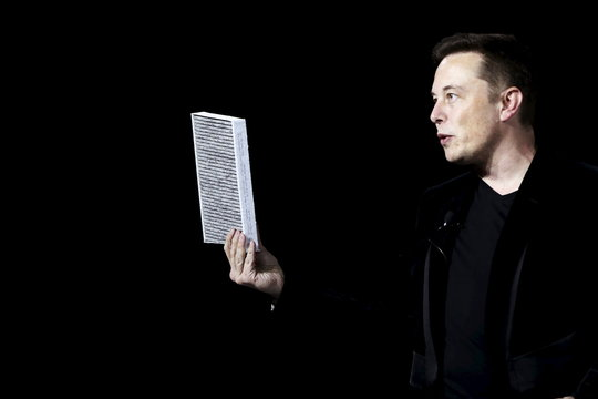 Tesla Motors CEO Elon Musk holds a car air filter during a presentation of the Model X electric sports-utility vehicle in Fremont