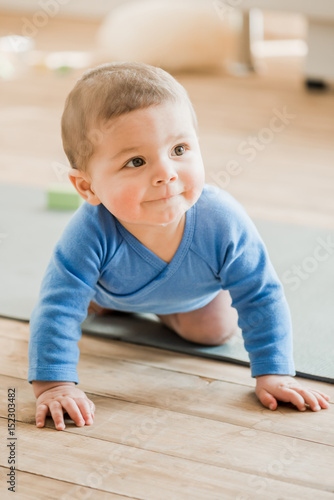 Funny Baby Boy Crawling On Yoga Mat And Smiling