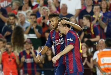 Barcelona's Messi celebrates his goal with teammate Neymar against Mexican club Leon during their Joan Gamper Trophy soccer match at Nou Camp stadium in Barcelona